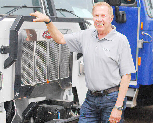John McLauglin infront of a New Way Truck Product